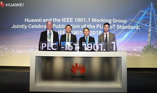 Huawei and IEEE representatives celebrate the publication of a new standard on power line communications for smart grid applications at the CIGRE power industry summit in Paris on 29 August