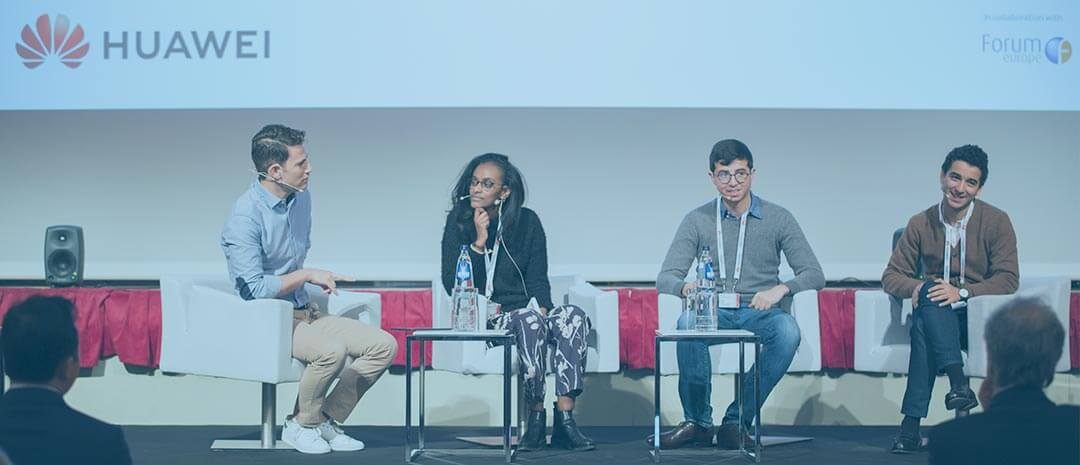 "From left to right: Dan Sobovitz, Digital Communication Strategist to the Vice-President of the European Commission, and Maha Elkheir from Huawei's Brussels Office discusses the future of AI with Ahmed Achchak and Hamza Sayah, students at French Grande École ""École Centrale Paris"" and participants of Huawei's European Student Challenge"