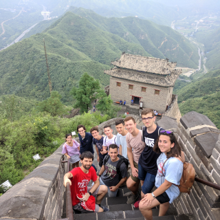 María and fellow Seeds for the Future participants climbing the Great Wall