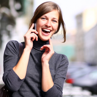 Happy young woman using a smartphone