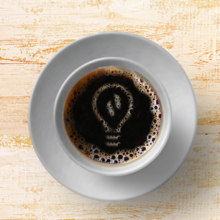 Coffee cup with lightbulb image